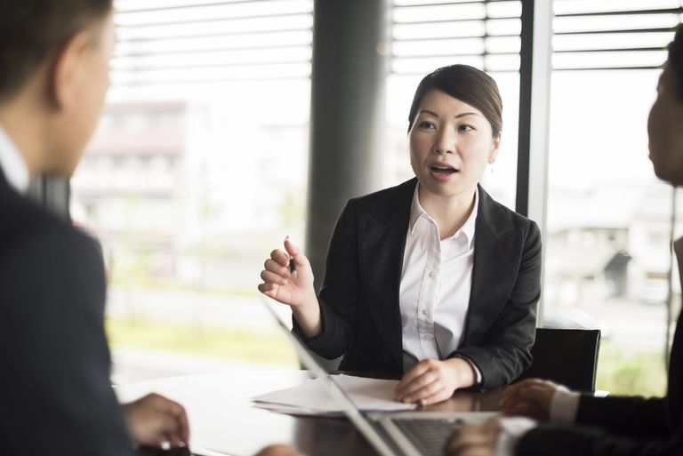 woman gesturing during job interview - What Challenges Are You Looking For In A Position Interview Question