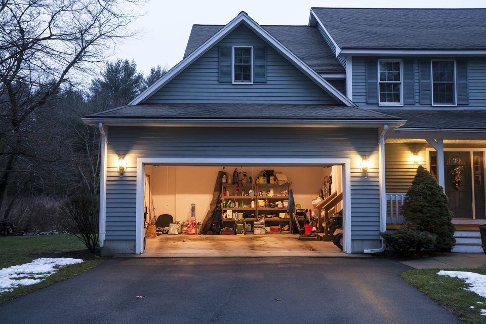 Upscale residential house has neat garage.