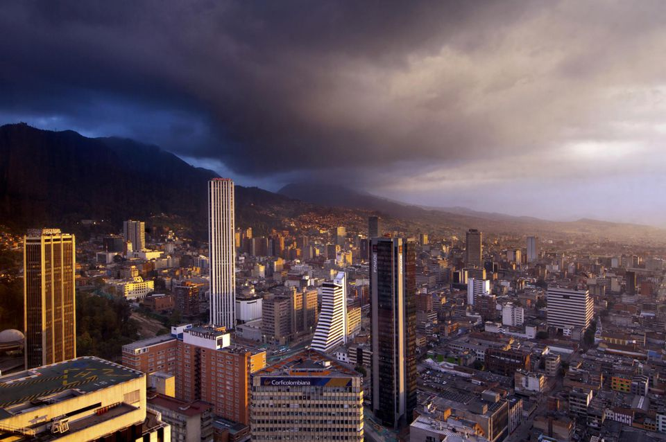 High rise office buildings of downtown Bogota at sunset looking south with the Andes Mountains rising to the east.