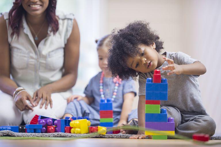 Little Boy Building a Tower