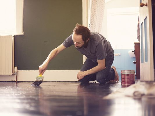 Man painting floor