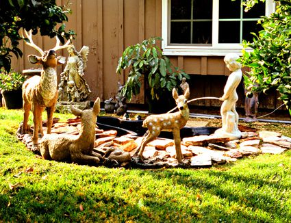 Installing french drains for yard drainage for Yard ornaments for sale