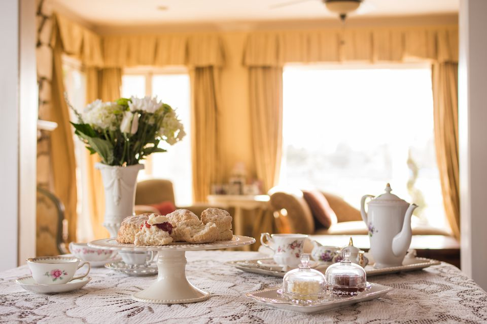 Prepared English tea and scones in living room