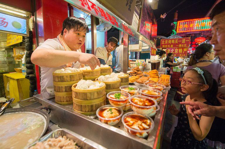 Man ordering dumplings at Donghuamen Snack Market