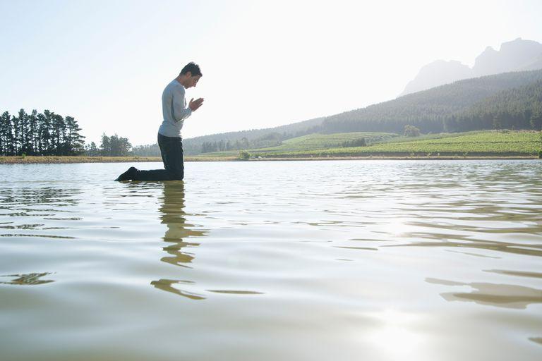 a man praying in the water