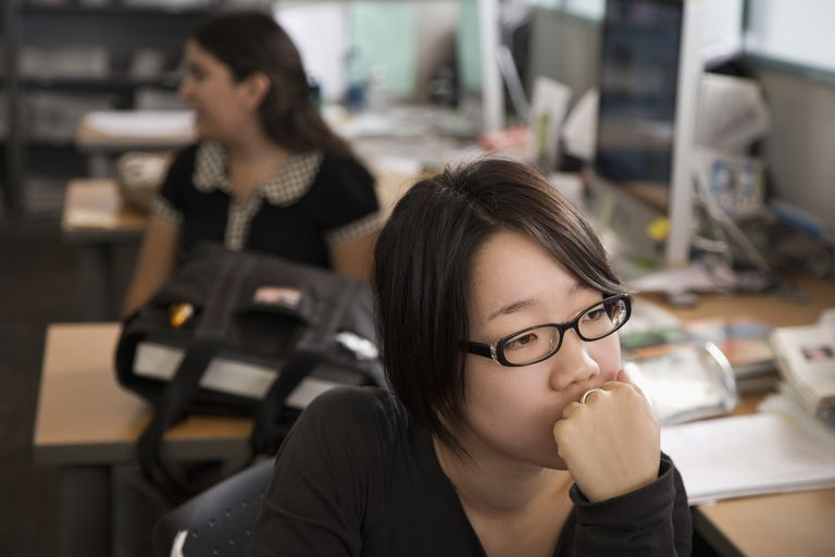 Japanese college student looking pensive