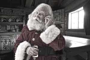 A picture of Santa making a phone call