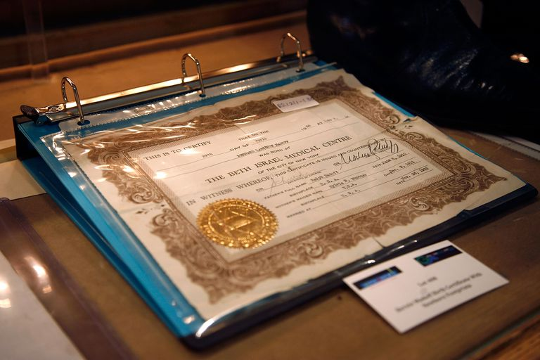 Birth Certificate protected in a notebook