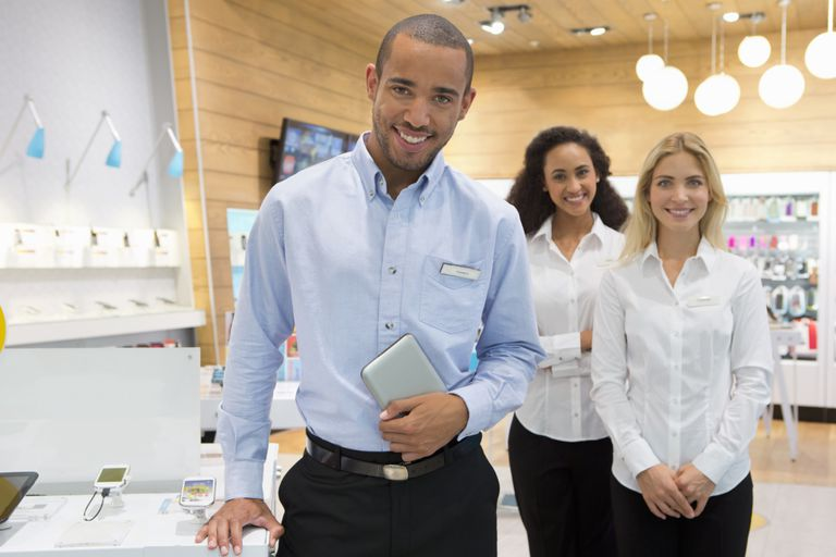 retail manager with team
