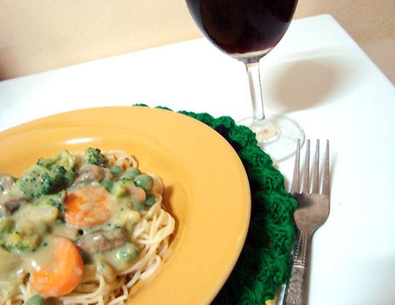 Vegan pasta primavera with broccoli, carrots and green peas