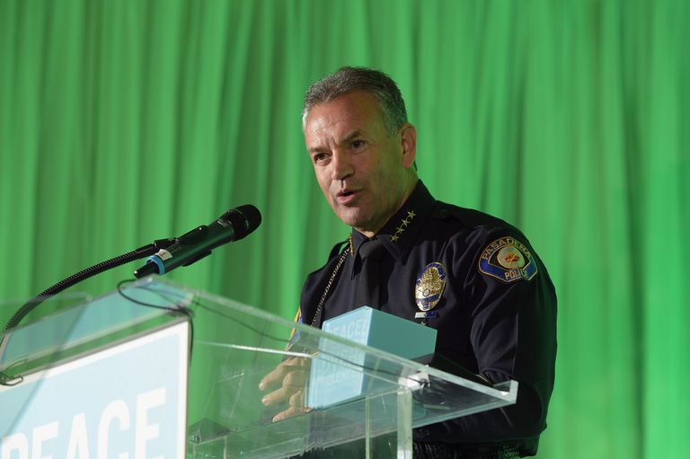 PASADENA, CA - SEPTEMBER 26, 2014: Pasadena Police Chief Phillip Sanchez accepts the Public Service Award onstage during the Peace Over Violence 43rd annual Humanitarian Awards at The Langham Huntington.