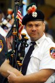 A Bagpiper from NYFD's Emerald Society
