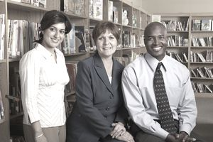 Principal with three teachers in school library, group portrait