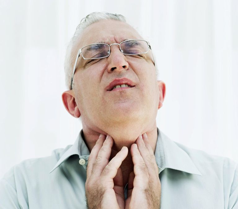 Mature man suffering from a sore throat