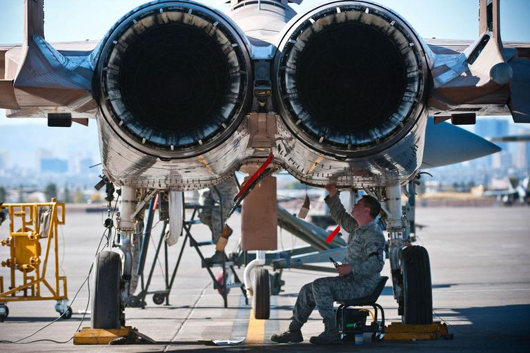 U.S. Air Force Airman 1st Class Bill Bossinger tightens wiring underneath a U.S. Air Force F-15 Eagle fighter aircraft during the mission employment phase exercise at Nellis Air Force Base, Nev., Dec. 7, 2012. Bossinger is assigned to the 757th Aircraft Maintenance Squadron electrical and environmental systems journeyman.