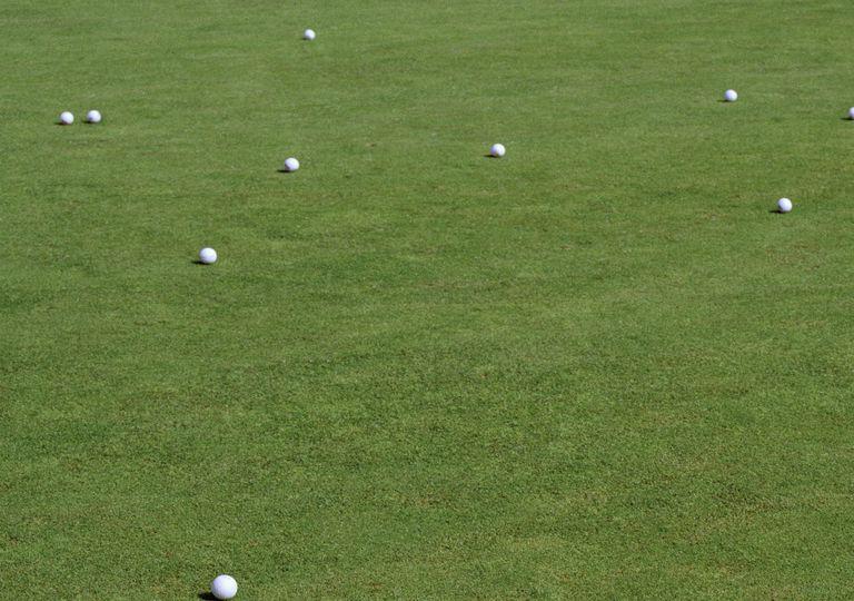 many golf balls on a putting green