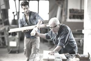 Carpenter and helper at work