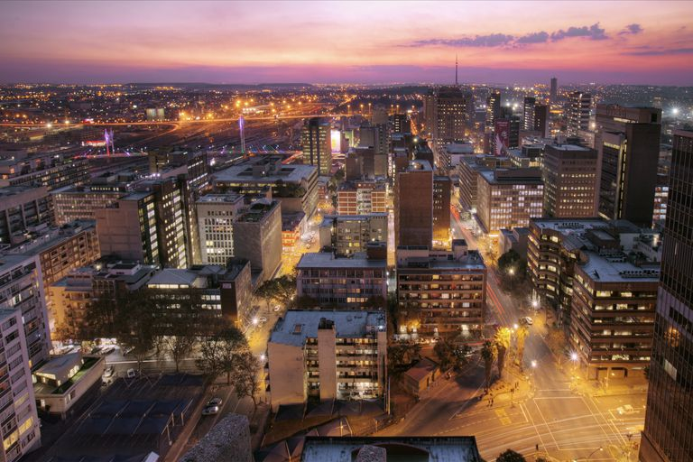 South Africa, Johannesburg, Sunset view of skyline and Nelson Mandela Bridge