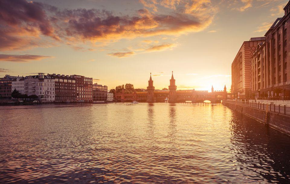 Berlin Oberbaum bridge with dramatic summer sunset sky