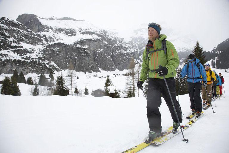 Switzerland, Davos, group of skiers ski touring in mountains