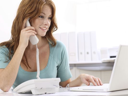 Businesswoman on Phone Rejecting an Applicant Who Didn't Get the Job