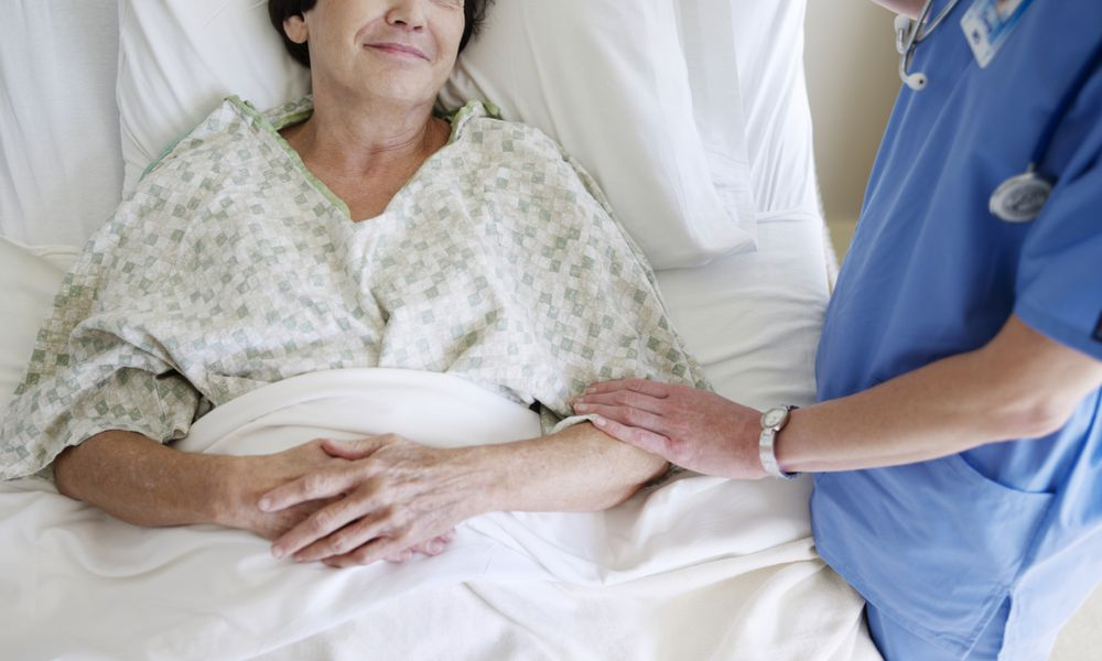 Nurse comforting patient