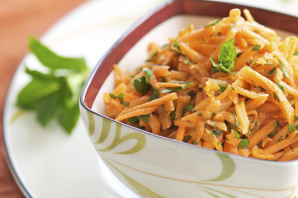Bowl of Shredded Carrot Salad with Chopped Herbs