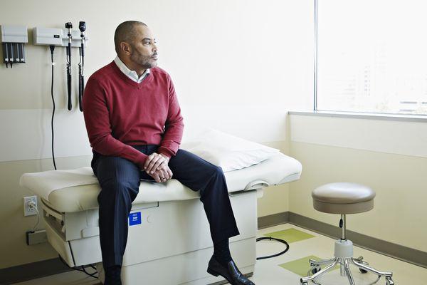 A man sits in a doctor's office.