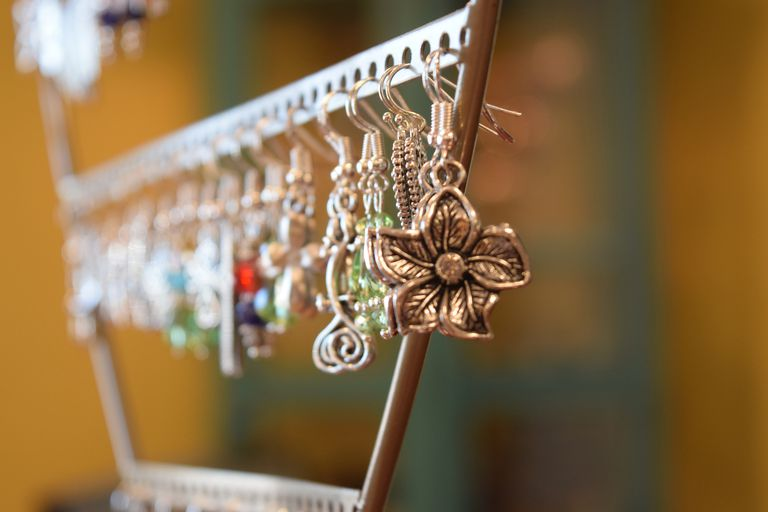 earrings hanging on a stand