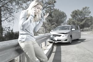 Car Accident and Woman on Phone