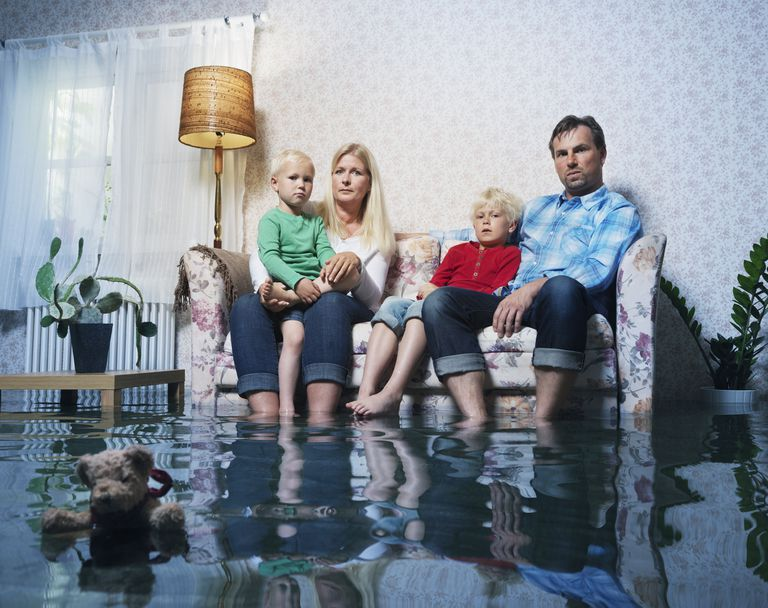 family in sofa in flooded room
