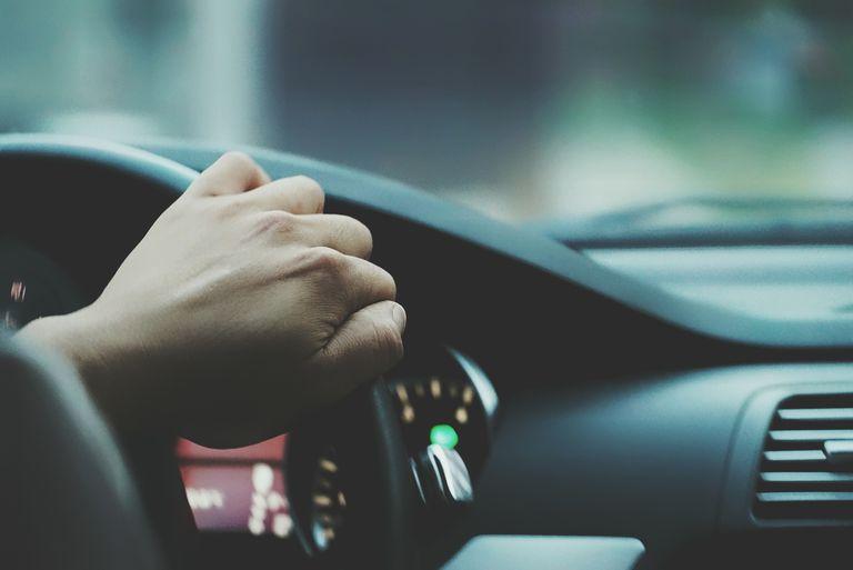 Detail Shot Of A Cropped Man Driving Car