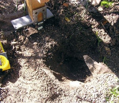 digging a post hole for arbor project