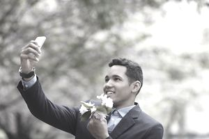 man with flowers phone