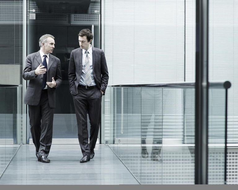 Portrait of two businessmen talking