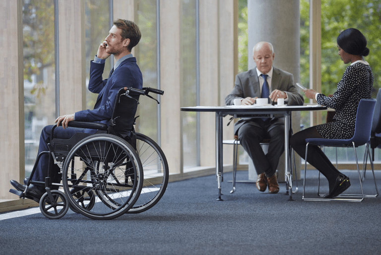 man in a wheelchair considering his disability benefits
