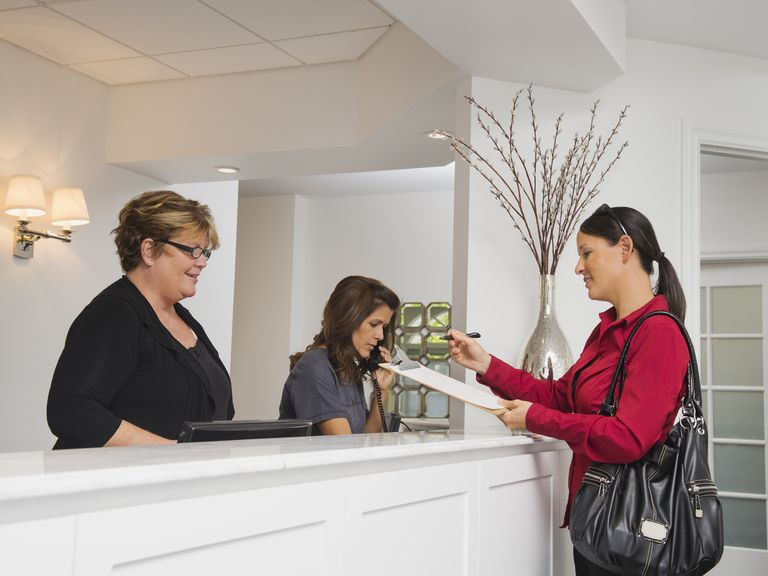 Female patient at doctor's office front desk