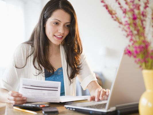 Brazilian woman paying bills online