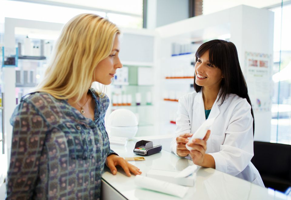 Woman talking to pharmacist about a prescription
