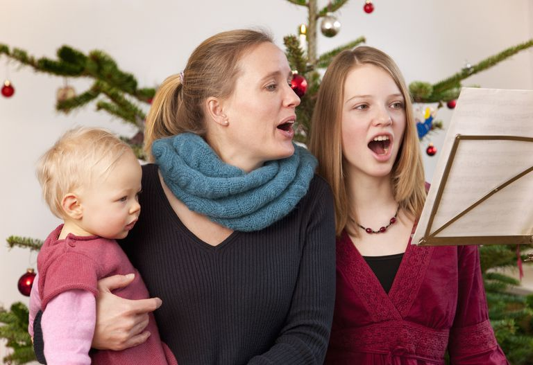 mother, daughter, baby singing carols