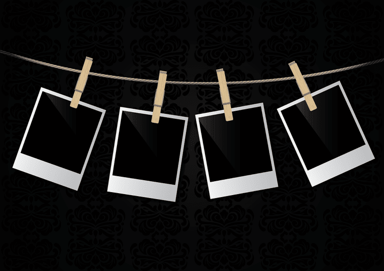 Instant photos hanging on rope