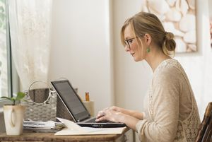 USA, New Jersey, Woman working with laptop