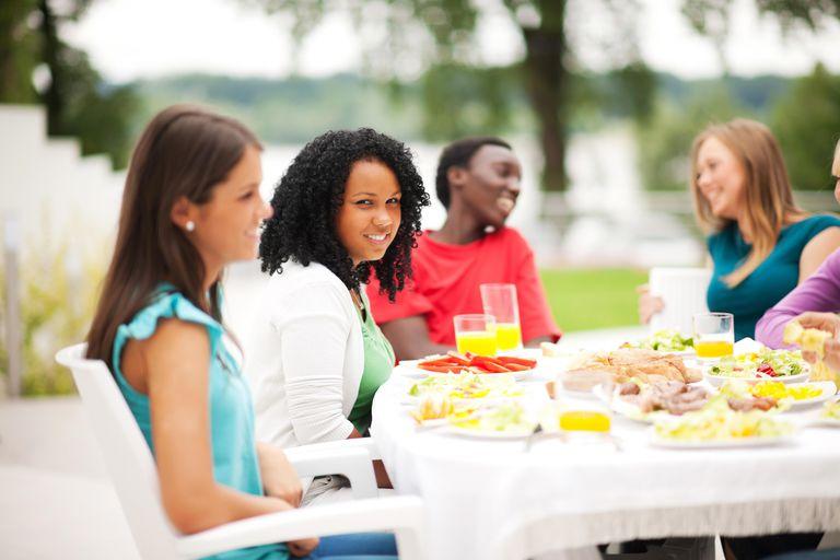 Group of friends having dinner outside.