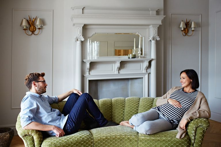 pregnant couple on couch