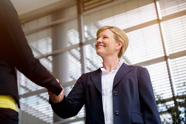 Businesswomen greeting