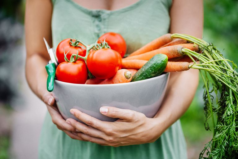 Woman holding fresh produce in a bowl
