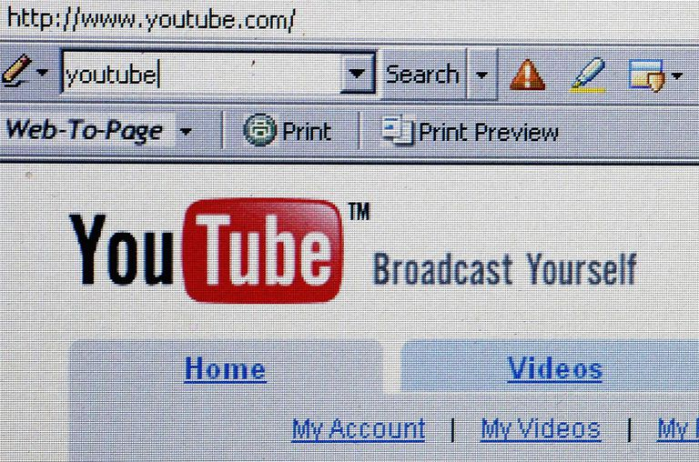 The YouTube website is displayed on October 10, 2006.