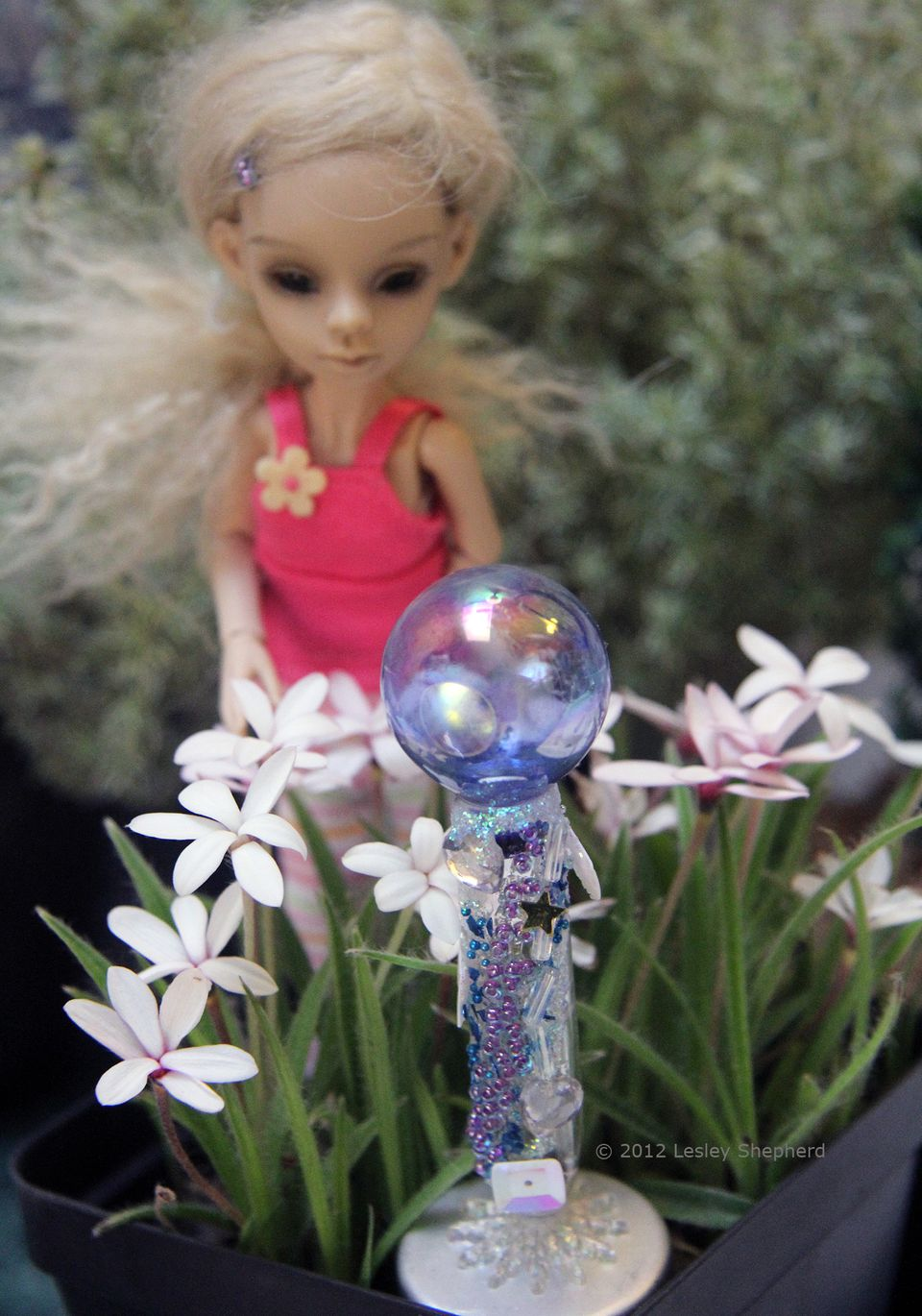 Miniature garden gazing globe in dolls house scale with a beaded base