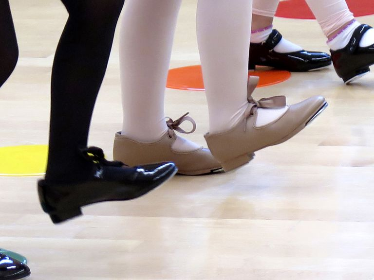 close-up of tap dancers' tap shoes