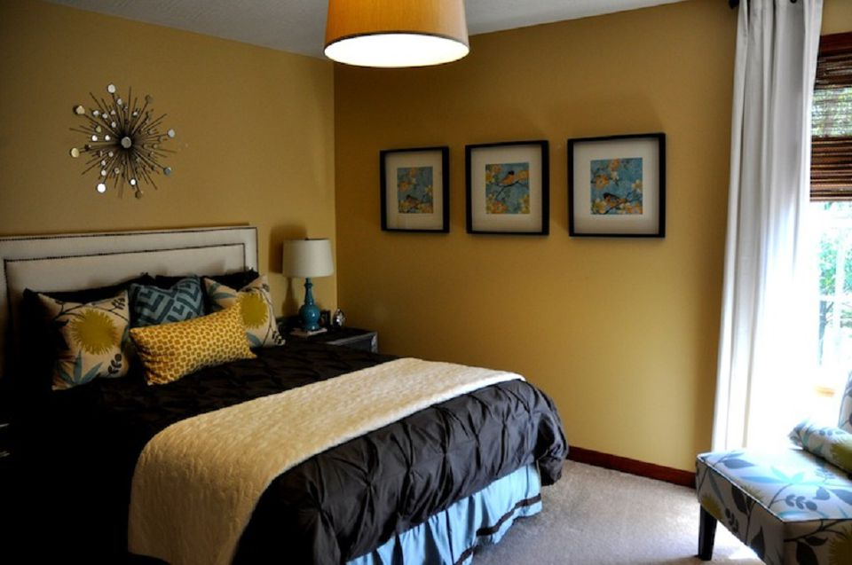 Contemporary golden yellow bedroom.